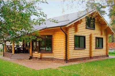 Строительство домов из оцилиндрованного бревна: типы материала