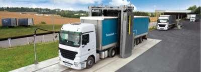 За счет чего проводится мойка грузовых автомобилей?